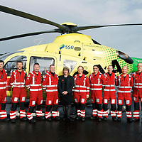 FREE TO USE PHOTOGRAPH....30.10.15<br /> Scotland's Charity Air Ambulance (SCAA) unveiled it's new helicopter at Perth airport this morning a EC135 T2i (pictured) which replaces the Bolkow 105 helicopter which is retiring from service. The new helicopter will increase speed, range, endurance and payload, allow SCAA to fly at night and in cloud. Scottish Health Minister Shona Robison MSP helped unveil the new helicopter...The Minister is pictured with the Paramedic team from left, Phillip Campbell, Mark Tynan, Craig McDonald, Chris Darlington, Julia Barnes, Paul Gowans, Alan Finlayson, John Salmond and Lead Paramedic John Pritchard.<br /> for further info please contact Maureen Young on 07778 779000<br /> Picture by Graeme Hart.<br /> Copyright Perthshire Picture Agency<br /> Tel: 01738 623350  Mobile: 07990 594431