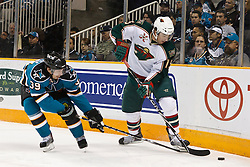 January 22, 2011; San Jose, CA, USA; Minnesota Wild left wing Andrew Brunette (15) keeps the puck away from San Jose Sharks center Logan Couture (39) during the first period at HP Pavilion. Mandatory Credit: Jason O. Watson / US PRESSWIRE