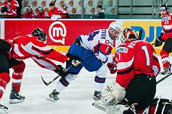 Matej Hocevar of Slovenia vs Fabian Weinhandl of Austria during ice-hockey match between Austria and Slovenia at IIHF World Championship DIV. I Group A Slovenia 2012, on April 21, 2012 at SRC Stozice, Ljubljana, Slovenia. (Photo By Matic Klansek Velej / Sportida.com)
