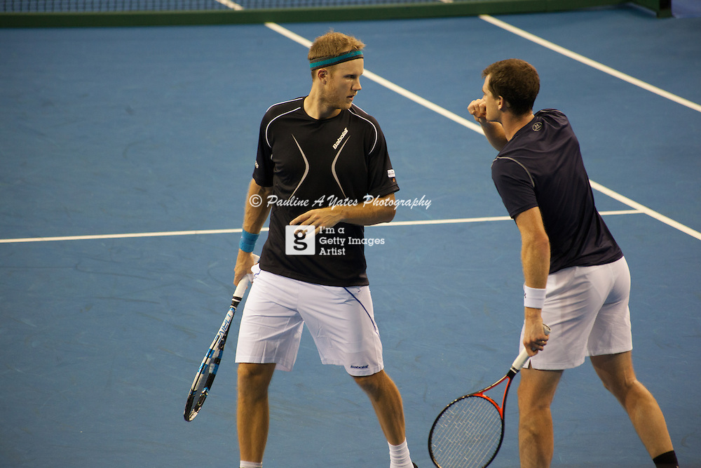 Dominic Inglot and Jamie Murray talk tactics before serving to the Bryan Brothers