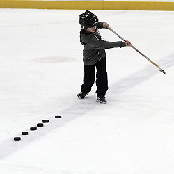 Mississauga, ON  - Feb 15 : Ontario Junior Hockey League game action between the Mississauga Chargers vs Cobourg Cougars, young fan takes shots on net to win a prize. <br /> (Photo by Kevin Sousa / OJHL Images)