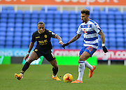 Bolton Wanderers midfielder Neil Danns and Reading midfielder Daniel Williams during the Sky Bet Championship match between Reading and Bolton Wanderers at the Madejski Stadium, Reading, England on 21 November 2015. Photo by Adam Rivers.