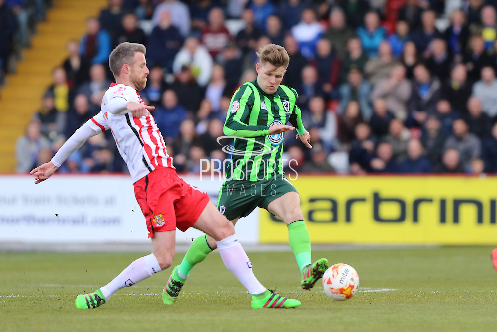 Michael Tonge midfielder for Stevenage FC (15) and Jake Reeves midfielder for AFC Wimbledon (8)  during the Sky Bet League 2 match between Stevenage and AFC Wimbledon at the Lamex Stadium, Stevenage, England on 30 April 2016. Photo by Stuart Butcher.