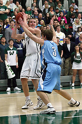 21 February 2015:  Brady Rose turns on the base line buts gets stopped short of the lane by Eric Leonard during an NCAA men's division 3 CCIW basketball game between the Elmhurst Bluejays and the Illinois Wesleyan Titans in Shirk Center, Bloomington IL