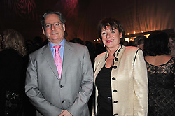 The HON.DOMINIC & the HON.ROSA LAWSON at the KIDS 40th Birthday Gala Dinner held in the Boiler House at Battersea Power Station, London on 10th March 2011.