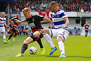 Queens Park Rangers defender Joel Lynch (6) keeps Nottingham Forest midfielder Ben Osborn (11)  away from goal during the EFL Sky Bet Championship match between Queens Park Rangers and Nottingham Forest at the Loftus Road Stadium, London, England on 29 April 2017. Photo by Andy Walter.