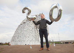Sir Chris Hoy visits the Kelpies in Falkirk, to celebrate 20 years on from the first National Lottery draw.