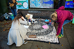© Licensed to London News Pictures. 22/12/2016. London, UK. A group of Heathrow protestors and their supporters set up a picnic area outside Ealing Magistrates Court in London, where 15 protestors are charged with Wilful Obstruction of the Highway after blocking an access road to Heathrow on November 18, 2016. Photo credit: Ben Cawthra/LNP