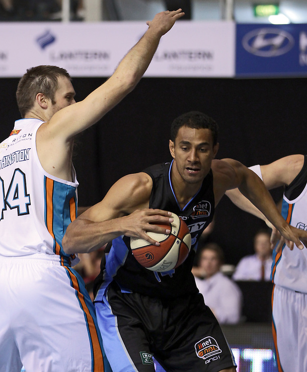 Breakers' Mika Vukona  in action against Blaze's Mark Worthington in an ANBL Basketball Match, North Shore Events Centre, Auckland, New Zealand, Thursday, December 08, 2011.  Credit:SNPA / David Rowland