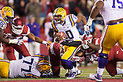 FAYETTEVILLE, AR - NOVEMBER 15:  Anthony Jennings #10 of the LSU Tigers runs the ball during a game against the Arkansas Razorbacks at Razorback Stadium on November 15, 2014 in Fayetteville, Arkansas.  The Razorbacks defeated the Tigers 17-0.  (Photo by Wesley Hitt/Getty Images) *** Local Caption *** Anthony Jennings