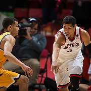 31 January 2017:  The San Diego State Aztecs men's basketball team hosts Wyoming Tuesday night at Viejas Arena. San Diego State guard Trey Kell (3) drives the ball up court against a Wyoming defender in the second half. The Aztecs beat the Cowboys 77-68 at half time. www.sdsuaztecphotos.com