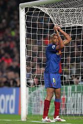 Thierry Henry of Barcelona grabs the net during the UEFA Champions League quarter final first leg match between FC Barcelona and FC Bayern Munich at the Camp Nou stadium on April 8, 2009 in Barcelona, Spain.