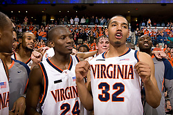 Virginia forward Mike Scott (32) and guard/forward Mamadi Diane (24) celebrate UVA's victory over Maryland.  The Virginia Cavaliers defeated the Maryland Terrapins 91-76 at the University of Virginia's John Paul Jones Arena  in Charlottesville, VA on March 9, 2008.