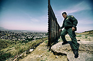 Border Patrol agent Mark Endicott  looks for activity where the border wall ends due to terrain, in Eastern Otay Mesa, CA on Thursday, June 8, 2017.(Photo by Sandy Huffaker for The New York Times)