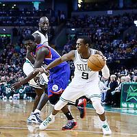 08 December 2012: Boston Celtics point guard Rajon Rondo (9) drives past Philadelphia 76ers point guard Jrue Holiday (11) on a screen set by Boston Celtics power forward Kevin Garnett (5) during the Boston Celtics 92-79 victory over the Philadelphia 76ers at the TD Garden, Boston, Massachusetts, USA.