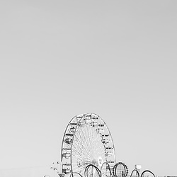 Santa Monica Pier Ferris Wheel at Pacific Park vertical black and white photo. Santa Monica is a coastal city in Southern California in the United States. Copyright ⓒ 2017 Paul Velgos with All Rights Reserved.