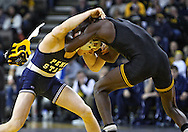 January 29, 2010: Iowa's Montell Marion's headgear goes flying off and he battles Penn State's Adam Lynch for control in the 141-pound bout at Carver-Hawkeye Arena in Iowa City, Iowa on January 29, 2010. Lynch won the match 8-6 and Iowa defeated Penn State 29-6.