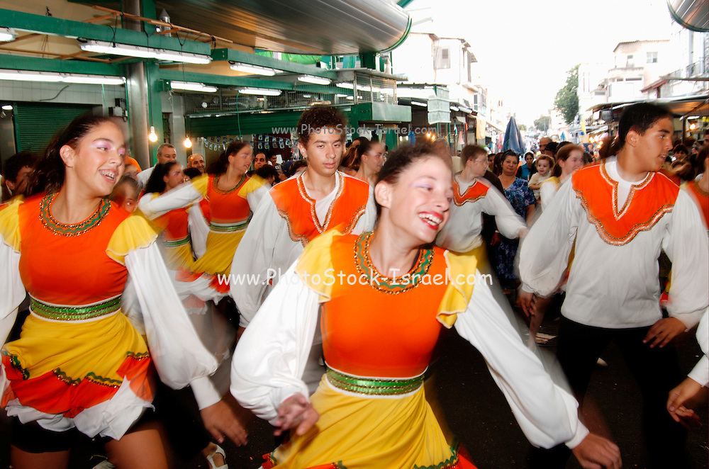 Israel, Tel Aviv A group of Israeli folk dancers dancing in the Hatikva market place