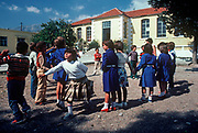 1970s schoolchildren play during break time at their school in rural Crete, on 13th Aril 1979, in Lasithi, Crete, Greece. (Photo by Richard Baker / In Pictures via Getty Images)