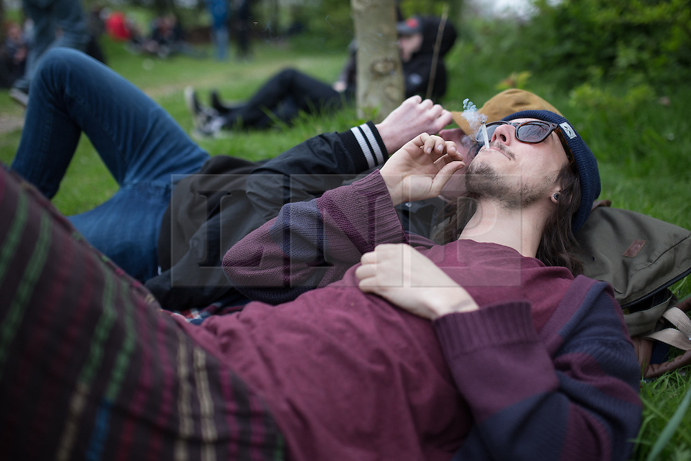 """© Licensed to London News Pictures . 20/04/2014 . Manchester , UK . Proponents for the legalisation of cannabis gather in Heaton Park in Manchester for """" 420 Day """". The event is organised by pro-cannabis groups ManCan and Mannijuana and is one of many taking place in cities across the world today (Sunday 20th April 2014) . Photo credit : Joel Goodman/LNP"""