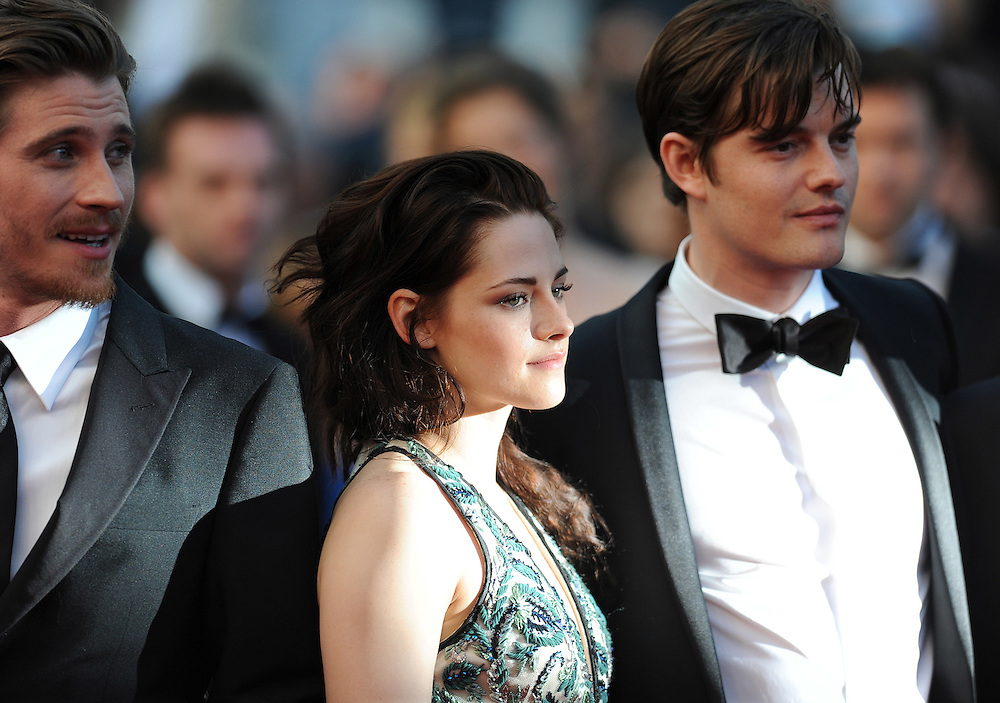 Actors left to right Walter Salles, Kristen Stewart & Sam Riley during the Red Carpet of 'On The Road' at  65th Annual Cannes Film Festival at Palais des Festivals on May 23, 2012 in Cannes, France..Photo Ki Price.