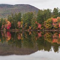 Beautiful fall color reflects in waters of Chocorua Lake, NH
