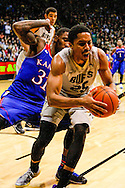 December 7th, 2013:  Colorado Buffaloes junior guard Spencer Dinwiddie (25) grabs a loose ball from Kansas Jayhawks redshirt sophomore forward Jamari Traylor (31) during first half action of the NCAA Basketball game between the Kansas Jayhawks and the University of Colorado Buffaloes at the Coors Events Center in Boulder, Colorado