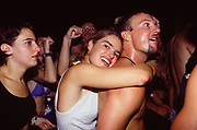Couple hugging in crowd, The Gallery club, London, 1990s.