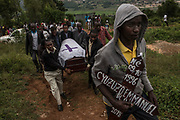 Joel Tuysenge, 17, leads the procession during the burial of his brother Emmanuel Cyuzuzo, 22, who passed away before receiving surgery to replace his aortic valve.<br /> <br /> Rheumatic heart disease is damage to one or more heart valves that stems from inadequately treated strep throat. Left untreated, rheumatic heart disease leads to heart failure.