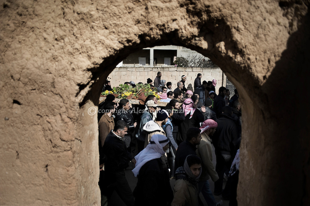 SYRIA - Al Qsair. Funeral of a member of  the Free Syrian Army, killed in Al Qsair, on February 9, 2012. ALESSIO ROMENZI