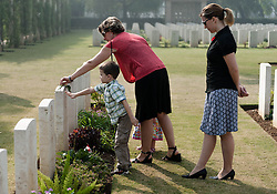 © Licensed to London News Pictures. 11/11/2012. Delhi, India. Family members place a flower on the gravestone of a relative who gave his/her life during a world war, at Delhi War Cemetery where a Remembrance Day ceremony was held today.   Remembrance Day (also known as Poppy Day or Armistice Day) is a memorial day observed in Commonwealth countries since the end of World War I to remember the members of their armed forces who have died in the line of duty. This day, or alternative dates, are also recognized as special days for war remembrances in many non-Commonwealth countries. Remembrance Day is observed on 11 November to recall the end of hostilities of World War I on that date in 1918.   Photo credit : Richard Isaac/LNP