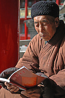 China, Wutai Shan, 2008. A monk takes in the February sun. Wutai is at a significant altitude, which makes it frequently inaccessible and subject to unpredictable weather.