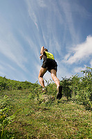 Man jogging in countryside backview