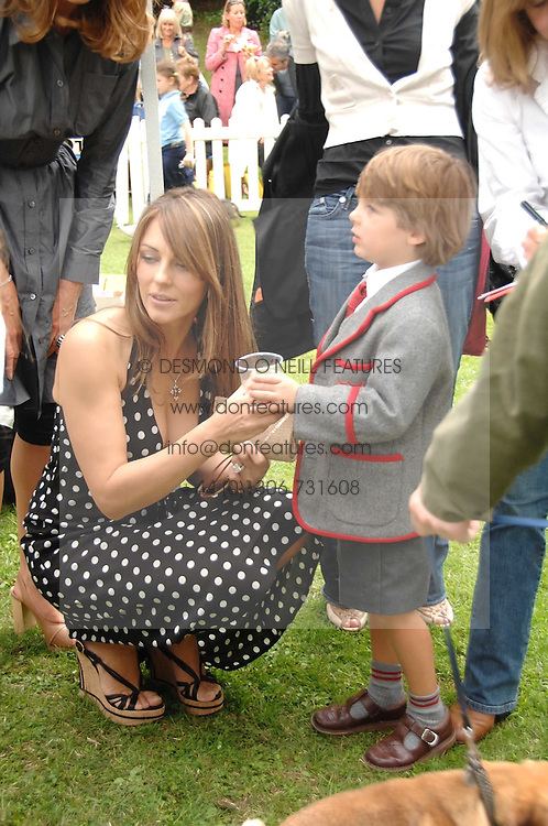 LIZ HURLEY and her son DAMON at Macmillan Dog Day in aid of Macmillan Cancer Support, held at Royal Hospital Chelsea, London on 3rd July 2007.<br />