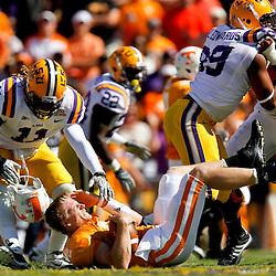 Oct 2, 2010; Baton Rouge, LA, USA; LSU Tigers linebacker Kelvin Sheppard (11) sacks Tennessee Volunteers quarterback Matt Simms (2) ripping off his helmet on the play during the first half at Tiger Stadium.  Mandatory Credit: Derick E. Hingle