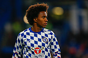 Chelsea midfielder Willian (22) warms up before the EFL Cup 4th round match between Chelsea and Derby County at Stamford Bridge, London, England on 31 October 2018.