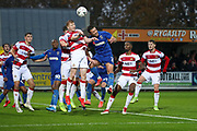 AFC Wimbledon defender Luke O'Neill (2) battles for possession with Doncaster Rovers defender Brad Halliday (2) during the The FA Cup match between AFC Wimbledon and Doncaster Rovers at the Cherry Red Records Stadium, Kingston, England on 9 November 2019.
