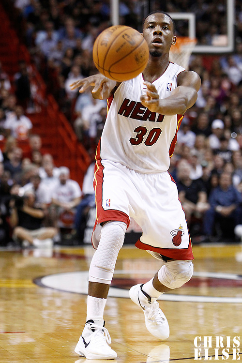 24 January 2012: Miami Heat point guard Norris Cole (30) passes the ball during the Miami Heat 92-85 victory over the Cleveland Cavaliers at the AmericanAirlines Arena, Miami, Florida, USA.