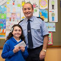 Summer Baylon from CBS NS, a winner in the recent Ennis Garda Síochána Crime Prevention Art Competition receiving her medal from Superintendant Derek Smart