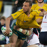Quade Cooper, Australia, gets the ball away in the tackle during the Australia V USA, Pool C match during the IRB Rugby World Cup tournament. Wellington Stadium, Wellington, New Zealand, 23rd September 2011. Photo Tim Clayton...