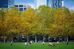 North America, United States, Washington, Bellevue. People playing games in Downtown Park in the autumn.