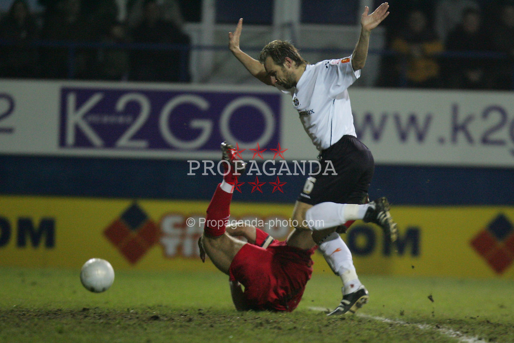 LUTON, ENGLAND - SATURDAY, JANUARY 7th, 2006: Liverpool's Steven Gerrard is brought down for a penalty by Luton Town's Paul Underwood during the FA Cup 3rd Round match at Kenilworth Road. (Pic by David Rawcliffe/Propaganda)