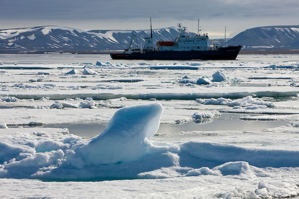 Norway, Svalbard, Edgeoya Island, Cruise ship motors through pack ice on summer morning
