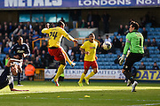 Odion Ighalo is prevented from scoring by Millwall goalkeeper David Forde during the Sky Bet Championship match between Millwall and Watford at The Den, London, England on 11 April 2015. Photo by David Charbit.