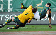 CAPE TOWN, SOUTH AFRICA - Saturday 28 September 2013, Morne Steyn of South Africa is tackled by Rob Simmons of Australia during the Castle Lager Rugby Championship test match between South Africa (Sprinkboks) and Australia (Wallabies) at DHL Newlands in Cape Town.<br /> Photo by Roger Sedres/ ImageSA
