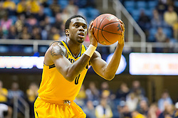 Dec 5, 2015; Morgantown, WV, USA; Kennesaw State Owls guard Kendrick Ray (0) shoots a foul shot during the first half against the West Virginia Mountaineers at WVU Coliseum. Mandatory Credit: Ben Queen-USA TODAY Sports