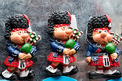 Detail of tourist fridge magnets of Scottish bagpipers for sale in souvenir shop on Royal Mile in Edinburgh, Scotland, United Kingdom