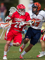Cornell Big Red M John Glynn (20) is defended by Virginia Cavaliers D Ken Clausen (27).  The #1 ranked Virginia Cavaliers defeated the #4 ranked Cornell Big Red 14-10 at Klockner Stadium on the Grounds of the University of Virginia in Charlottesville, VA on March 8, 2009.