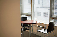 Empty office with water glass on table