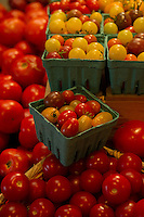 A variety of tomatoes fill the bins at Moulton Farm in Meredith ready for your holiday BBQ's.  (Karen Bobotas/for the Laconia Daily Sun)
